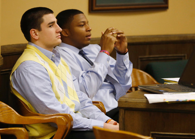 . Trent Mays (L) and Ma\'lik Richmond (R) sit in juvenile court during a recess in Steubenville, Ohio, March 14, 2013. The judge deciding the fate of two high school football players in Ohio accused of raping a drunk classmate last summer will hear more testimony on Thursday from prosecution witnesses - and more sharp questioning from defense attorneys - as the trial enters its second day. REUTERS/Keith Srakocic/Pool