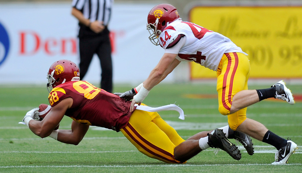 . TE Jalen Cope-Fitzpatrick makes a diving catch under safety Rob Dooley at USC\'s Spring Football Game. (Michael Owen Baker/Staff Photographer)