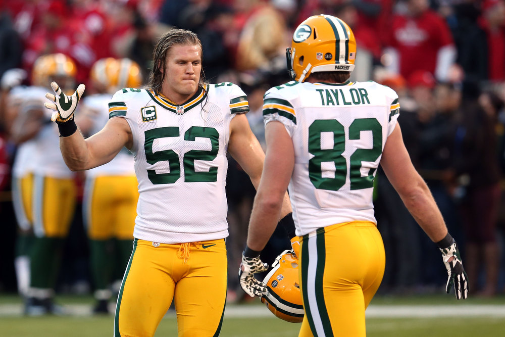 Description of . Outside linebacker Clay Matthews #52 of the Green Bay Packers high-fives teammate tight end Ryan Taylor #82 during warm ups prior to the NFC Divisional Playoff Game against the San Francisco 49ers at Candlestick Park on January 12, 2013 in San Francisco, California.  (Photo by Stephen Dunn/Getty Images)