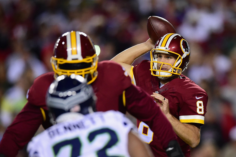 . Quarterback Kirk Cousins #8 of the Washington Redskins passes in the first half of a game against the Seattle Seahawks at FedExField on October 6, 2014 in Landover, Maryland.  (Photo by Patrick Smith/Getty Images)