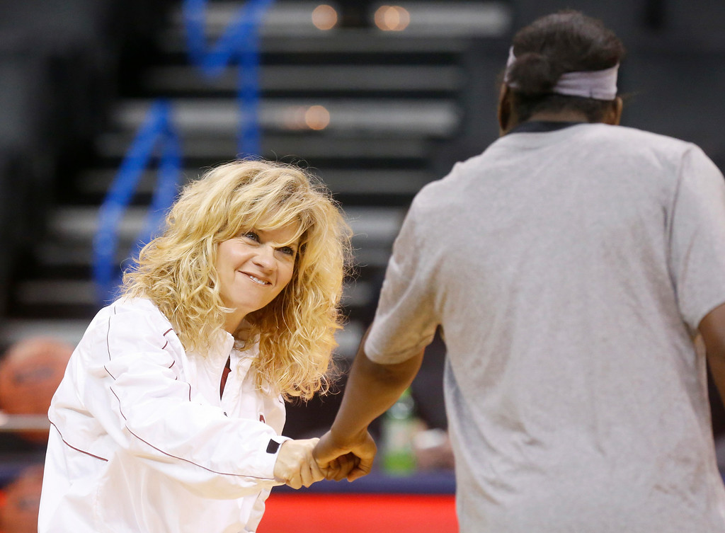 . Oklahoma head coach Sherri Coale fist bumps with forward Felisha Gibbs, right, during a team practice for the Big 12 women\'s NCAA college basketball tournament in Oklahoma City, Friday, March 7, 2014. Oklahoma faces Texas on Saturday. (AP Photo/Sue Ogrocki)