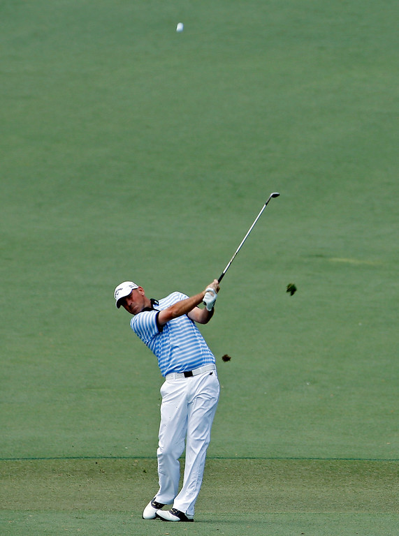 . Thomas Bjorn, of Denmark, hits off the second fairway during the fourth round of the Masters golf tournament Sunday, April 13, 2014, in Augusta, Ga. (AP Photo/Matt Slocum)