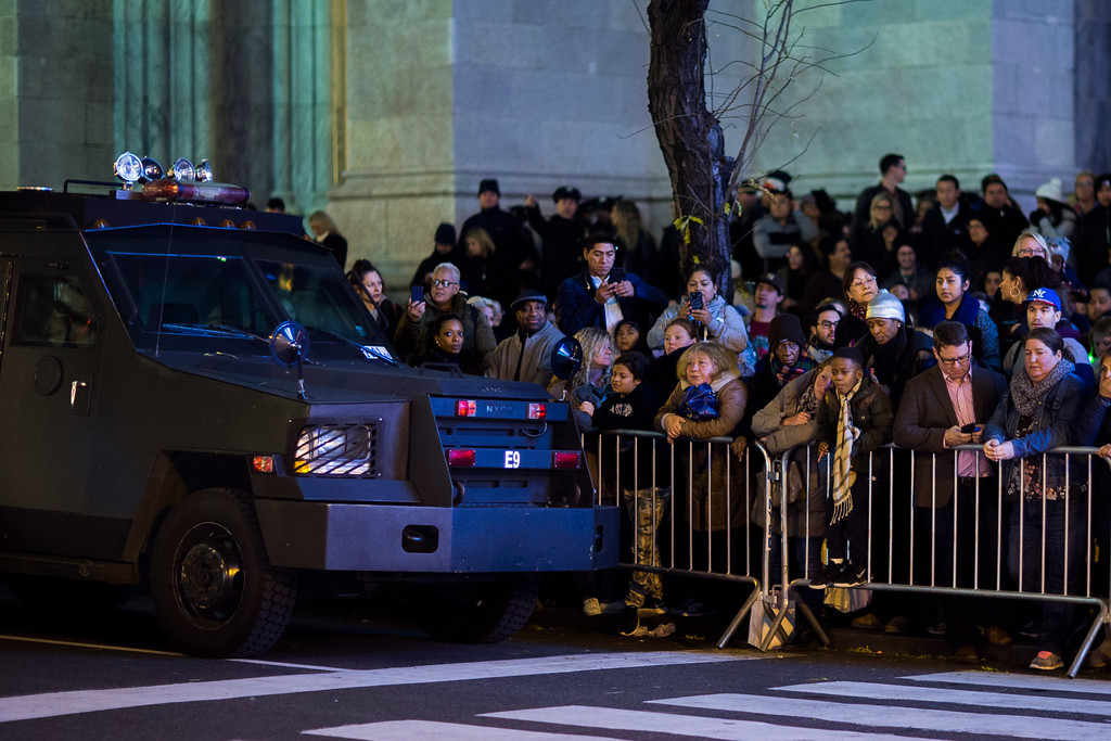 . People wait for the Rockefeller Center Christmas tree to be lit next to heavily armed police patrol near Rockefeller Center during the 85th annual Rockefeller Center Christmas tree lighting ceremony, Wednesday, Nov. 29, 2017, in New York. (AP Photo/Andres Kudacki)