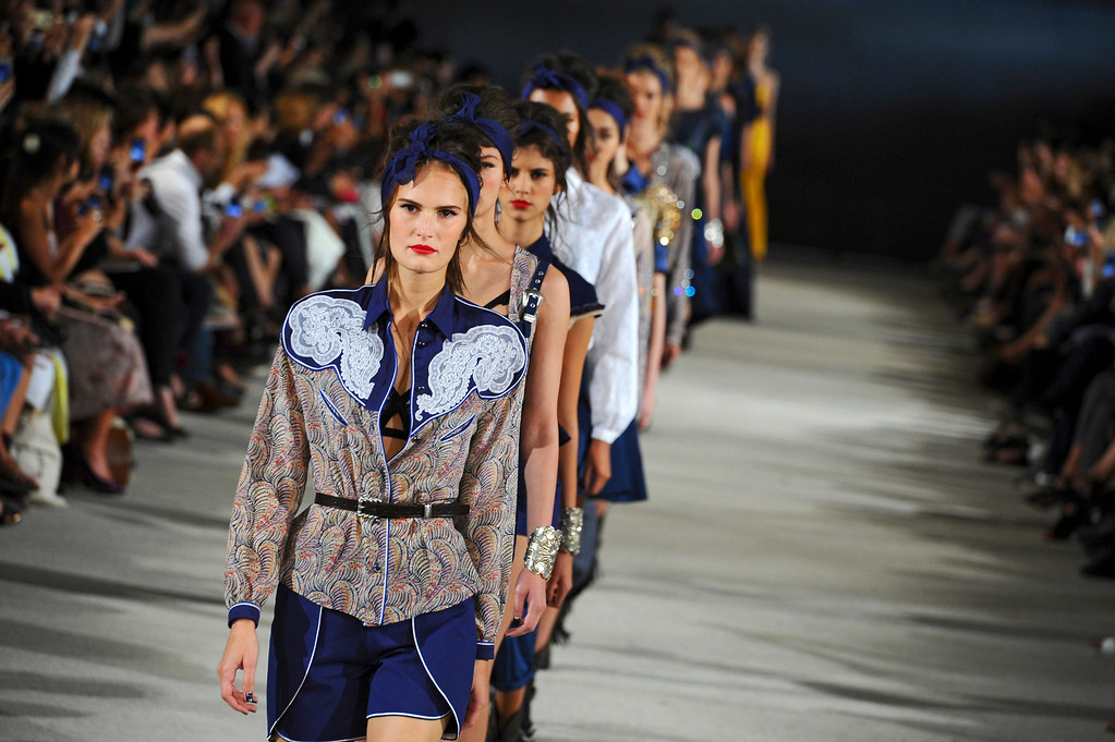 . Models present creations as part of French fashion designer Alexis Mabille\'s ready-to-wear Spring/Summer 2014 fashion collection presented in Paris, Wednesday, Sept. 25, 2013. (AP Photo/Zacharie Scheurer)