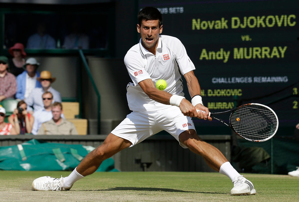 . Serbia\'s Novak Djokovic returns against Britain\'s Andy Murray during the men\'s singles final on day thirteen of the 2013 Wimbledon Championships tennis tournament at the All England Club in Wimbledon, southwest London, on July 7, 2013.  ANJA NIEDRINGHAUS/AFP/Getty Images