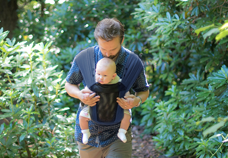 Izmi_Baby_Carrier_Breeze_Midnight_Blue_Lifestyle_Front_Facing_Carry_Dad_In_Woodland.jpg