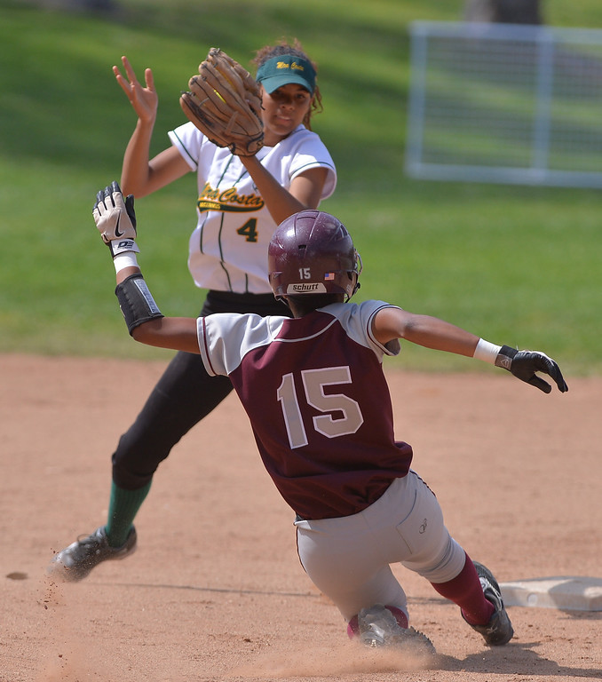 . 0517_SPT_TDB-L-MC-TORRANCE--- Torrance, CA--5/16/13--- Staff Photo: Robert Casillas  - Daily Breeze / LANG--- Mira Costa defeated Torrance High 7-1 in CIF DIV III softball playoff game at Wilson Park in Torrance. Sydney Haugh tags out Kamryn Watts on attempted steal