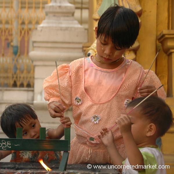 Kids Lighting Incense at Shwedagon Paya - Rangoon, Burma (Yangon, Myanmar)