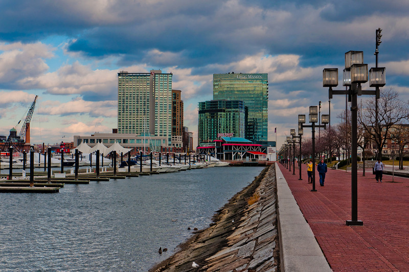 Waterfront path and view of highrises in Baltimore, Maryland.
