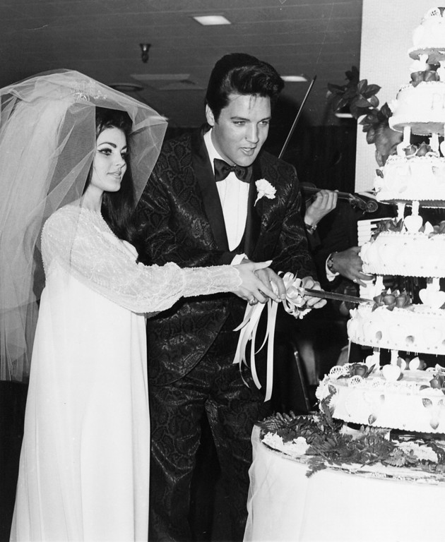 . ***FOR USE AS DESIRED IN CONNECTION WITH THE 30TH ANNIVERSARY OF ELVIS\' DEATH--FILE This May 1967 file photo of Elvis Presley and his new bride Priscilla cutting the cake at their wedding reception in Las Vegas is transmitted for use as desired in connection with the 30th anniversary of his death. (AP Photo)