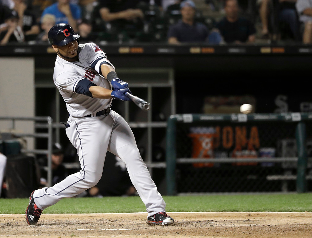 . Cleveland Indians\' Edwin Encarnacion hits an RBI single off Chicago White Sox relief pitcher Jace Fry during the eighth inning of a baseball game Wednesday, June 13, 2018, in Chicago. (AP Photo/Charles Rex Arbogast)