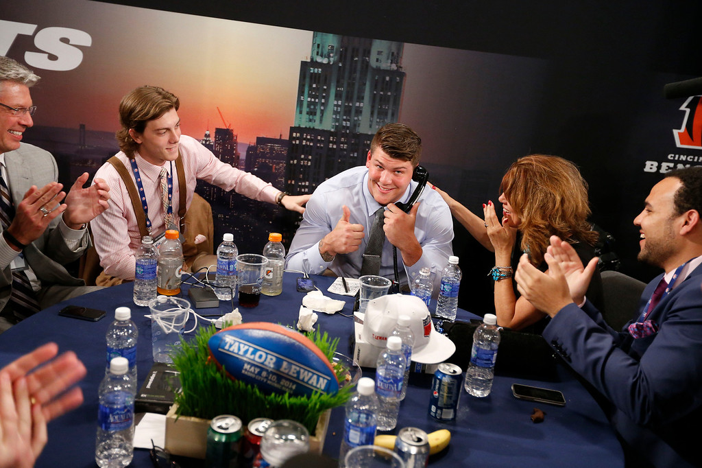 . Taylor Lewan, from Michigan, reacts after being selected 11th overall by the Tennessee Titans in the first round of the NFL football draft, Thursday, May 8, 2014, at Radio City Music Hall in New York. (AP Photo/Jason DeCrow)
