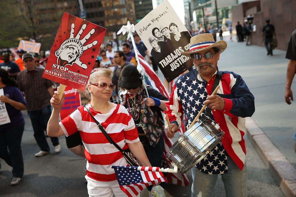 . CHICAGO, IL - MAY 01:  Demonstrators participate in a May Day march on May 1, 2013 in Chicago, Illinois. Hundreds of marchers participated in the two-mile march from the city\'s West side into the Loop. The majority of the marchers were protesting for immigration reform.  (Photo by Scott Olson/Getty Images)