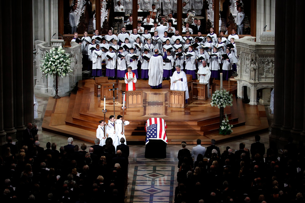 . The choir sings at a memorial service for Sen. John McCain, R-Ariz., at Washington National Cathedral in Washington, Saturday, Sept. 1, 2018. McCain died Aug. 25, from brain cancer at age 81. (AP Photo/Pablo Martinez Monsivais)