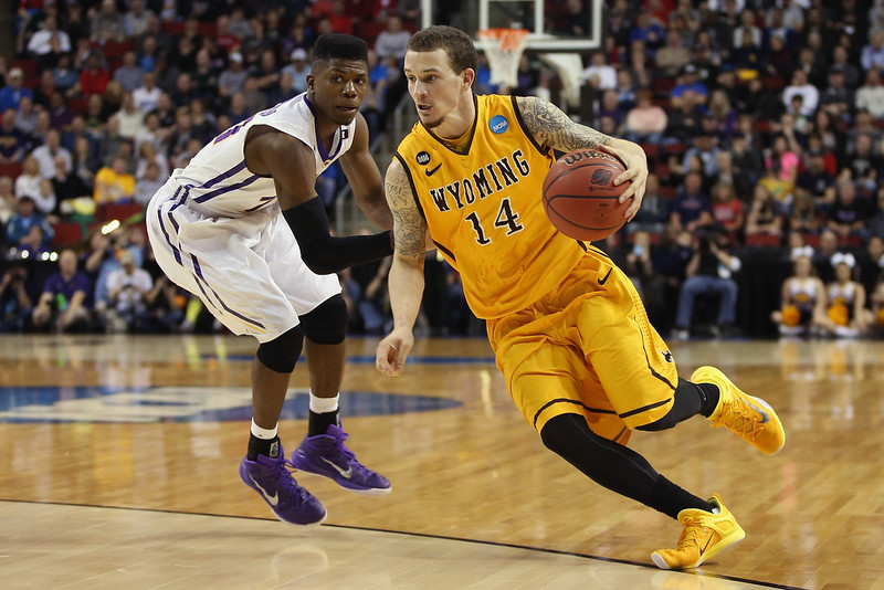 . Josh Adams #14 of the Wyoming Cowboys drives against Wes Washpun #11 of the Northern Iowa Panthers during the second round of the 2015 Men\'s NCAA Basketball Tournament at KeyArena on March 20, 2015 in Seattle, Washington.  (Photo by Otto Greule Jr/Getty Images)