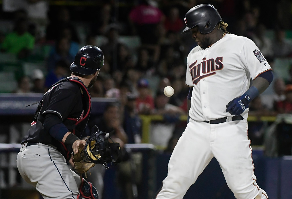 . Cleveland Indians catcher Yan Gomes looks at the ball on a wild pitch to Minnesota Twins\' Miguel Sano during the 15th inning of a baseball game at Hiram Bithorn Stadium in San Juan, Puerto Rico, Wednesday, April 18, 2018. (AP Photo/Carlos Giusti)