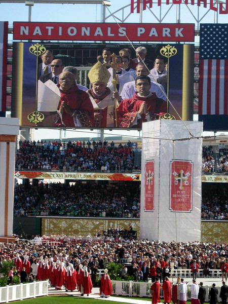 Pope Benedict XVI enters the stadium again to begin the Mass