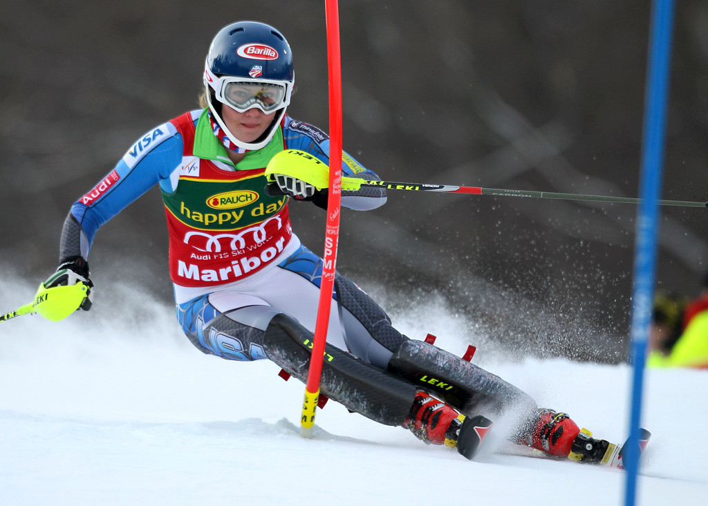 . Mikaela Shiffrin, of the United States, speeds down the course during the first run of an alpine ski, women\'s world Cup slalom, in Maribor, Slovenia, Sunday, Jan. 27, 2013. (AP Photo/Marco Trovati)