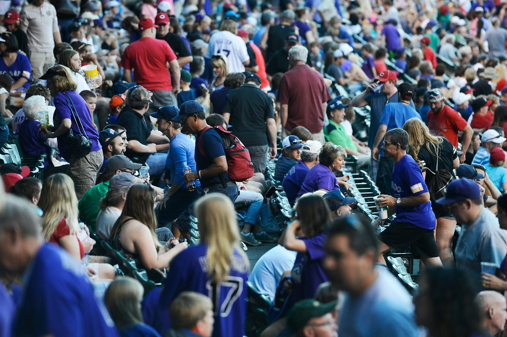 . DENVER, CO. - AUGUST 16:  Colorado Rockies fans head up the isles of Coors Field Saturday evening, August 16, 2014 after the announcement came that the game against the Cincinnati Reds was cancelled due to a water main break along Blake St, cutting off water supply to the stadium. (Photo By Andy Cross / The Denver Post)