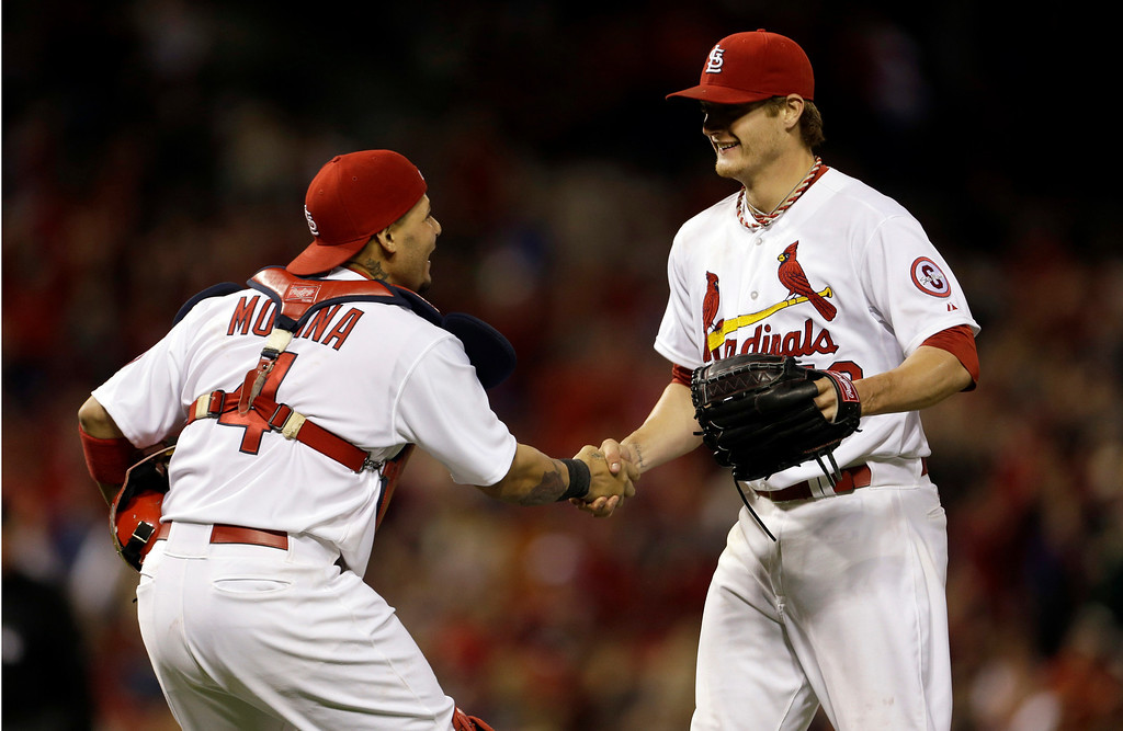 . St. Louis Cardinals starting pitcher Shelby Miller, right, is congratulated by catcher Yadier Molina after throwing a complete baseball game against the Colorado Rockies, Friday, May 10, 2013, in St. Louis. Miller gave up one hit in the 3-0 victory. (AP Photo/Jeff Roberson)