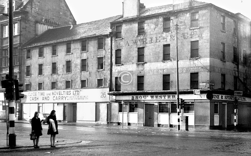 Bridge St, west side at Kingston St.   The Sou' Wester is still there, the building cut down to a single storey, and so, remarkably, is its neighbour which probably dates from c1795 and originally had a nepus gable.    December 1973