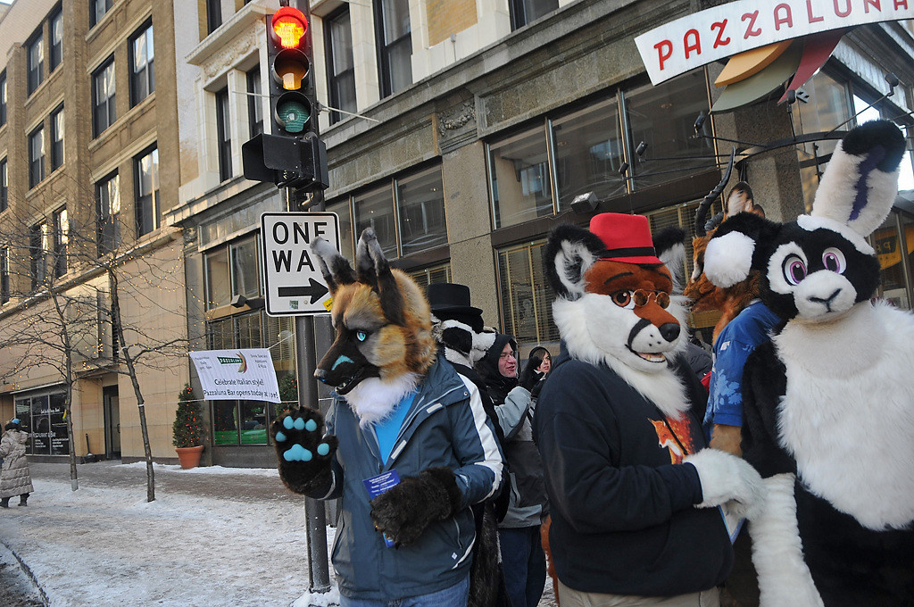 . Parade marchers from Minnesota Fur gather together by Pazzaluna at the end of the Winter Carnival Grande Day Parade in St. Paul, Saturday January 25, 2014.  (Pioneer Press: Jean Pieri)