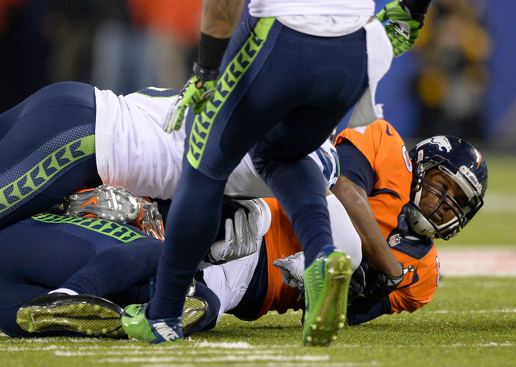 . Denver Broncos tight end Julius Thomas (80) hits the ground after a catch during the second quarter. The Denver Broncos vs the Seattle Seahawks in Super Bowl XLVIII at MetLife Stadium in East Rutherford, New Jersey Sunday, February 2, 2014. (Photo by John Leyba/The Denver Post)