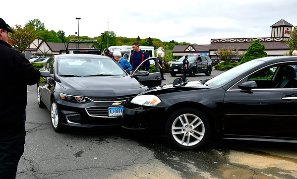 5/14/2019 Mike Orazzi | Staff The scene of a two-vehicle crash in the Bristol Commons parking lot on Tuesday morning. No injuries were reported and both care were towed from the scene.