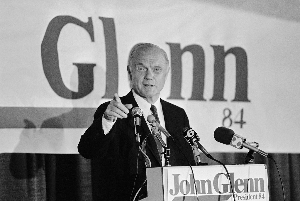 . Presidential Candidate, Ohio Senator, John Glenn gestures as he speaks to reporters during a news conference at a downtown Richmond Hotel on  Thursday, Feb. 17, 1984 Glenn appeared with Virginia Governor, Charles Robb at several fund raiser receptions at the Hotel. (AP Photo/Steve Helber)