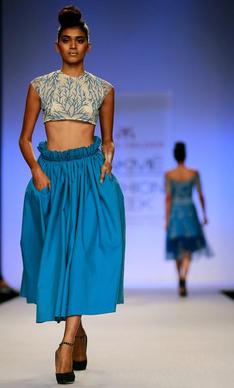 . A model displays a creation by designer Asmita Marwa during the Lakme Fashion Week in Mumbai, India, Thursday, March 13, 2014. (AP Photo/Rafiq Maqbool)