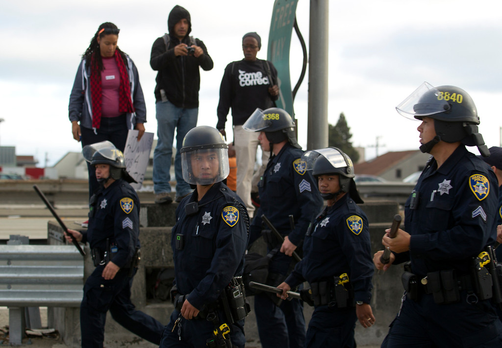 . Oakland, Calif. police attempt to remove demonstrators from Interstate Highway 880 during a protest of the verdict in the Trayvon Martin murder trial last Saturday in Sanford, Fla., Monday, July 15, 2013 in Oakland, Calif. (D. Ross Cameron/Bay Area News Group)