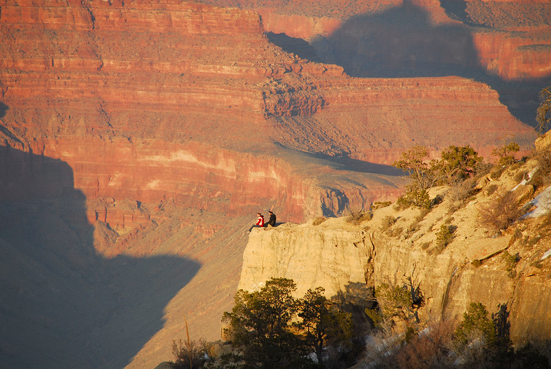 Two friends contemplate the enormity of the canyon