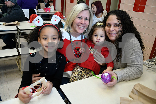 12/16/2017 Mike Orazzi | Staff Principal Karen Falvey Nylah Hardie,7, Elyse Perez,2, and Natasha Gerena at the Smith Elementary School's Breakfast with Santa on Saturday morning in New Britain.