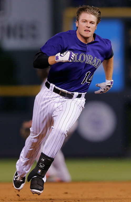 . Colorado Rockies\' Josh Rutledge heads to third after hitting a two run triple off San Francisco Giants starting pitcher Yusmeiro Petit during the third inning of a baseball game Tuesday, Sept. 2, 2014, in Denver. (AP Photo/Jack Dempsey)