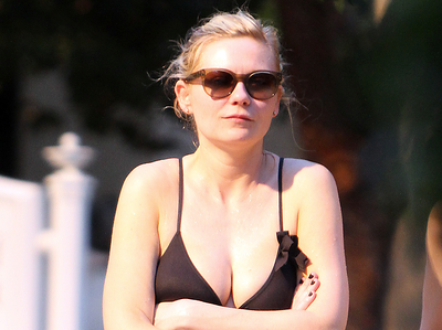 EXC: Kirsten Dunst Shows Off Her Trim Figure In A Black Bikini