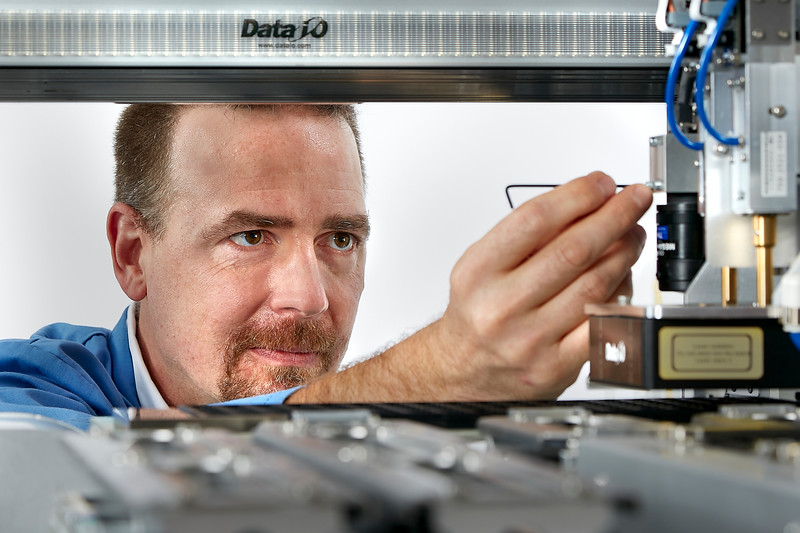 Technician Adjusting Complex Electronics