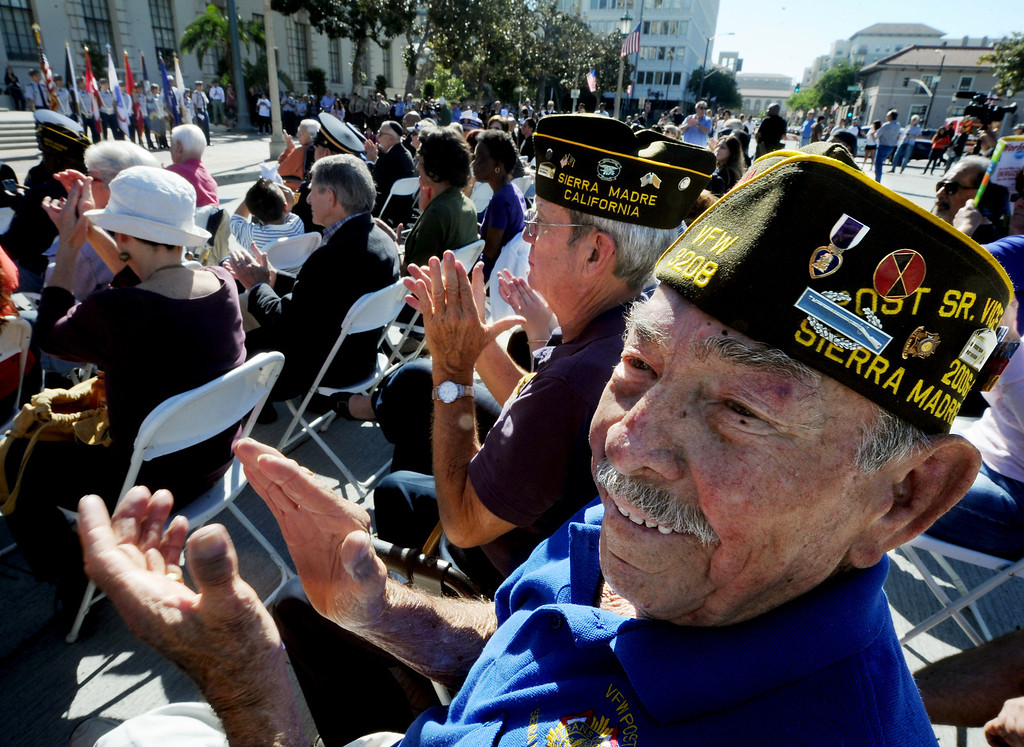 . Members of Sierra Madre Post, Stan Pinta of Arcadia, and Art Contreras, right, enjoying the speakers at Pasadena��ôs annual Veterans Day Ceremony in front of Pasadena City Hall at Centennial Square. Monday, November 11, 2013. The public, veterans, their families, friends and all uniformed military and first-responders, joined together to help honor the men and women of the U.S. Armed Forces. This year��ôs event, while recognizing the important contributions made by all veterans, will have a special emphasis on honoring the nation��ôs youngest and newest veterans. The Veterans Day celebration is co-sponsored by the Pasadena Veterans Day Committee and the City of Pasadena.(Photo by Walt Mancini/Pasadena Star-News)