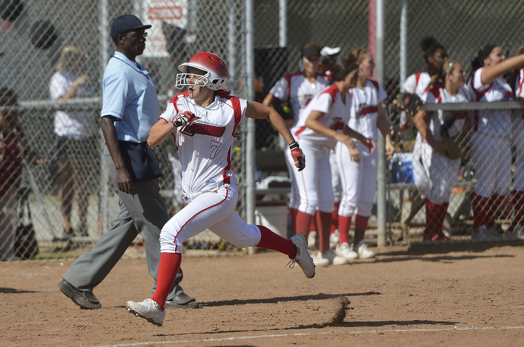 . LONG BEACH, CALIF. USA -- Lakewood\'s Adrianna Schultz (7) heads towards home against Wilson in Lakewood, Calif., on May 2, 2013. Lakewood defeated Wilson 11-1 in five innings. Photo by Jeff Gritchen / Los Angeles Newspaper Group