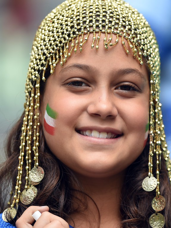 . A young fan of Iran smiles before a Group F football match between Bosnia-Hercegovina and Iran at the Fonte Nova Arena in Salvador during the 2014 FIFA World Cup on June 25, 2014.      AFP PHOTO / JAVIER SORIANO/AFP/Getty Images