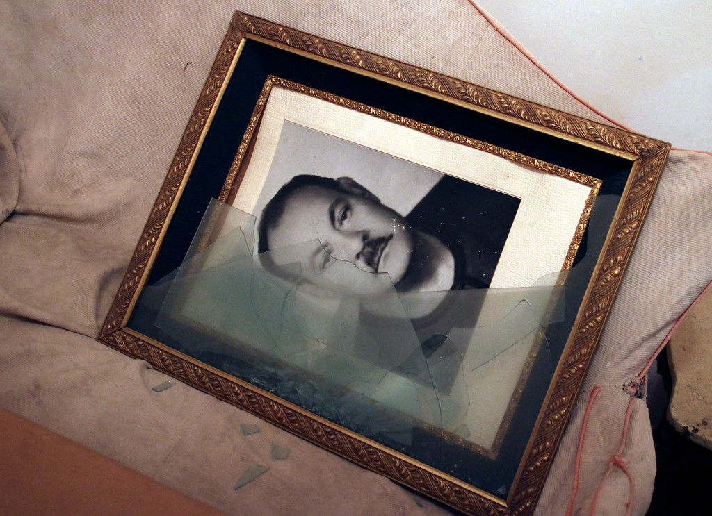 . This Sept. 3, 2013, photo, shows a broken picture frame holding an image of the father of Talaat Bassily, a prominent Christian businessman, whose home was looted by criminals in Malawi, Minya province, Egypt. With the Egyptian army and police already fighting a burgeoning Islamist insurgency in the strategic Sinai peninsula near the border with Gaza and Israel, there are growing signs that a second insurgency could erupt in the Nile-side Minya province and Assiut to the south -- both strongholds of Islamists and home to Egypt\'s two largest Christian communities. (AP Photo/El Shorouk Newspaper, Roger Anis)