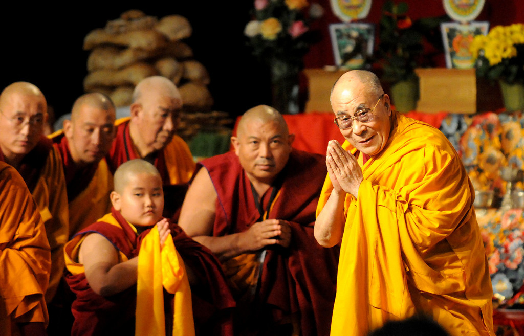 . The Dalai Lama, alongside monks, addresses the 2,500 people who came to see him during the Losar celebration. (Pioneer Press: Sherri LaRose-Chiglo)