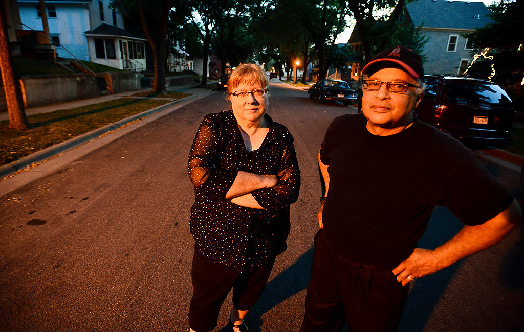 ". For years, Jim Wardlaw and Holly Evans-Wardlaw have stood guard on the 600 block of St. Paul�s East Fourth Street. ""At one time, I hated this neighborhood,\"" James Wardlaw says. \""But things are getting better.\"" (Pioneer Press: Ben Garvin)"