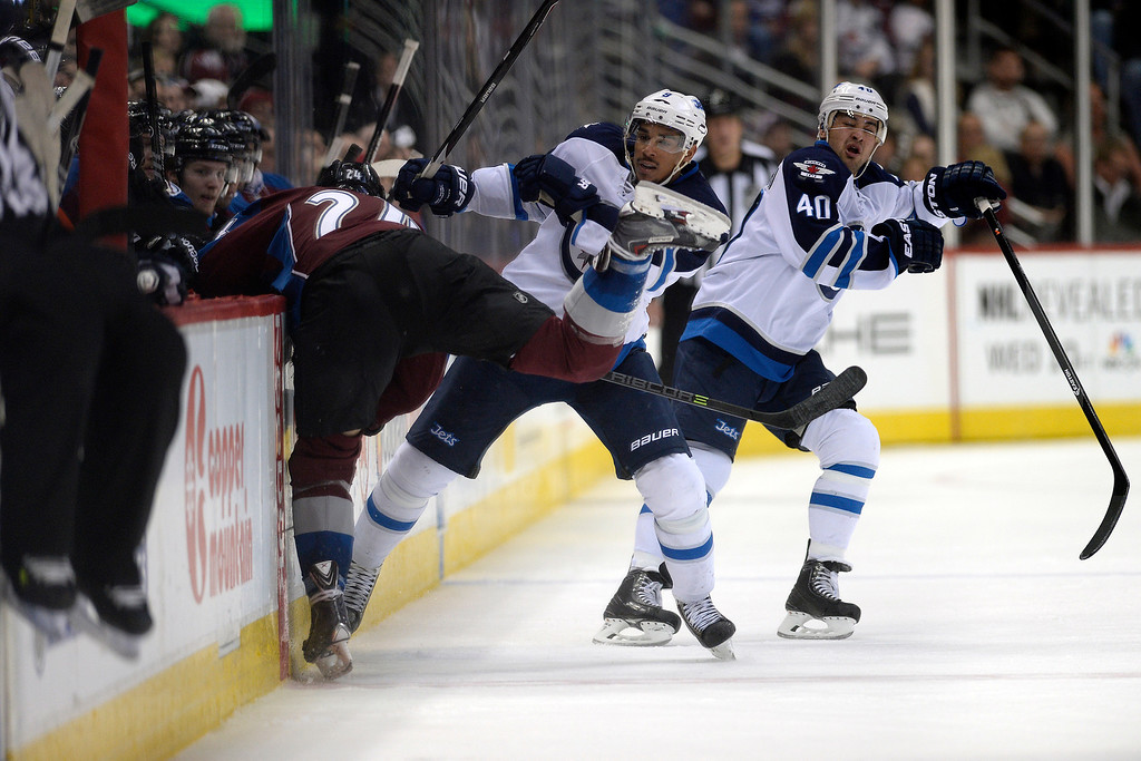 . Evander Kane (9) of the Winnipeg Jets checks Marc-Andre Cliche (24) of the Colorado Avalanche as Devin Setoguchi (40) aids during the Avs\' 3-2 win. (Photo by AAron Ontiveroz/The Denver Post)