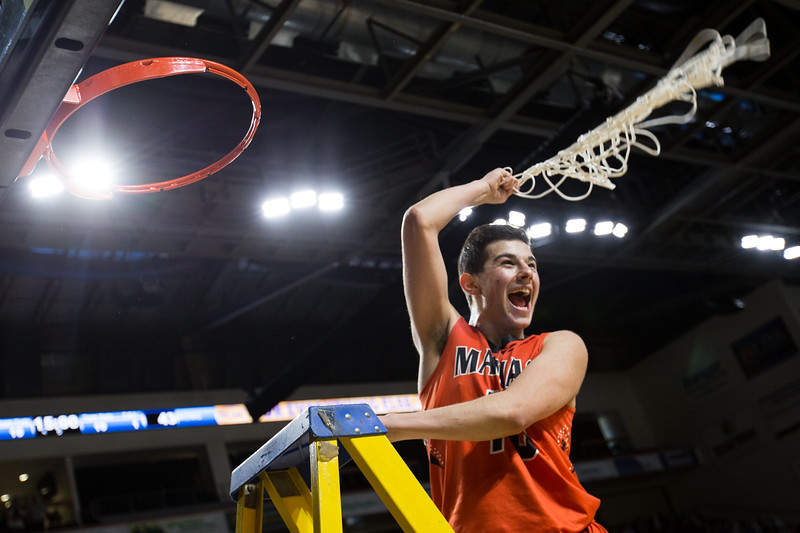 BANGOR, MAINE -- 02/25/2017 -- Machias' John Massaad swings the net and screams for cheering fans following their class D boys basketball championship win against Southern Aroostook on Saturday morning at the Cross Insurance Center in Bangor. Micky Bedell | BDN