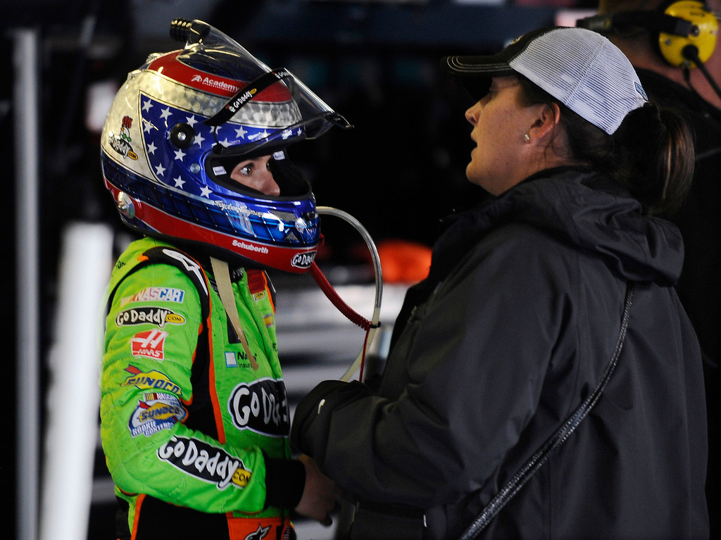 . Danica Patrick talks with a team member in the Nationwide garage after crashing early in the NASCAR Nationwide Series auto race at Talladega Superspeedway in Talladega, Ala., Saturday, May 4, 2013. (AP Photo/Rainier Ehrhardt)