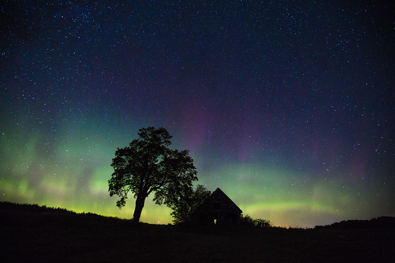 Aurora Borealis over an abandoned house, Presque Isle, Maine, USA