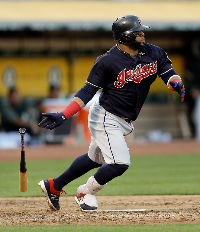 . Cleveland Indians\' Carlos Santana drops his bat after hitting an RBI ground out off Oakland Athletics\' Paul Blackburn during the sixth inning of a baseball game Saturday, July 15, 2017, in Oakland, Calif. (AP Photo/Ben Margot)