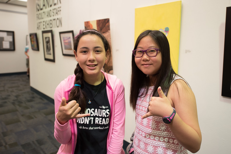 Fiona Forbes and Anna Han pause for a photo during the Young Writers Camp in the Mary and Jeff Bell Library.