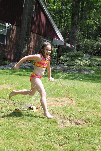 Young Girl Running Through Sprinklers, Tamaqua (5-30-2011)