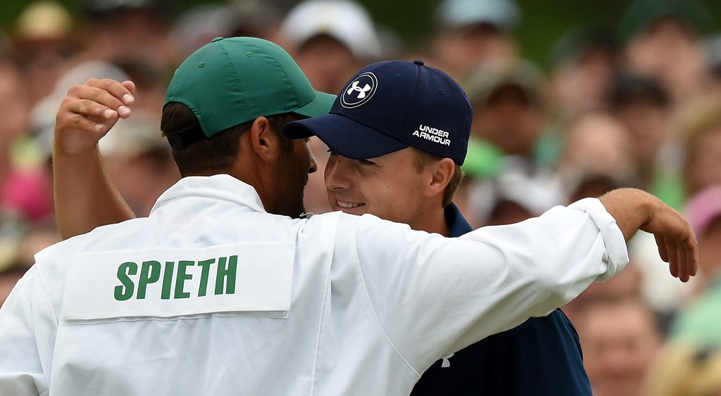 . Jordan Spieth (R) of the US hugs caddie, Michael Greller, as he celebrates winning the 79th Masters Golf Tournament at Augusta National Golf Club on April 12, 2015, in Augusta, Georgia.  DON EMMERT/AFP/Getty Images